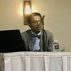 A picture of Ather Sharif giving the Keynote Address at the 2019 Evergreen International Conference