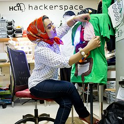 Co-inventor of BodyVis Leyla Norooz sitting next to her invention