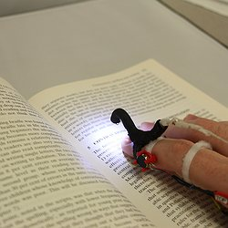 An early HandSight prototype for reading printed text