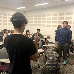 High school students trying Dhruv's AR-based captioning system