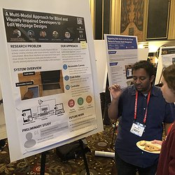 Venkatesh showing our UITalk poster at ASSETS'19